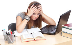 Sick and tired of studying. Girl, at table, having trouble studying Stock Photography
