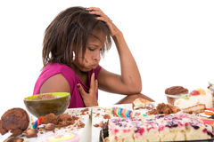Sick to her stomach. Pretty black looking very sick after having eaten too much sweets Stock Photo