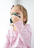 Sick toddler girl Stock Image