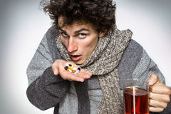 Sick wasted man taking medicine tablets Royalty Free Stock Photos