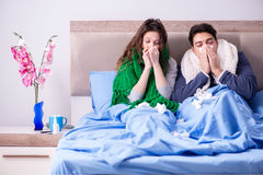 The sick wife and husband in bed in home Stock Image