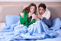 The sick wife and husband in bed in home Stock Photos