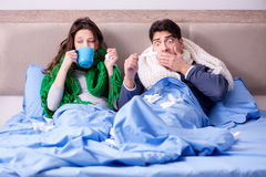 The sick wife and husband in bed in home Royalty Free Stock Photos