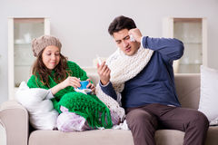 The sick wife and husband at home Stock Image