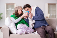 The sick wife and husband at home Royalty Free Stock Photos