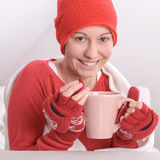 Sick woman. With a cup of hot tea stock photos