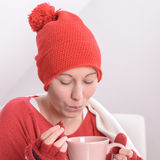 Sick woman. With a cup of hot tea Stock Photo