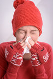 Sick woman. Blowing her nose Stock Images