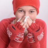 Sick woman. Blowing her nose Stock Photos