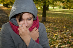 Sick woman. In the park Stock Photography