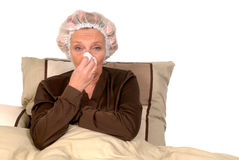 Sick woman in bed Stock Photos