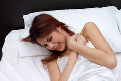 Sick woman on bed, with heart attack, extreme danger and critica Royalty Free Stock Image