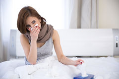 Sick woman on the bed at home Stock Photos