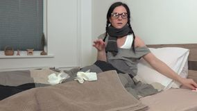 Sick woman in the bed with runny nose. In room stock footage