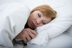 sick woman in bed with thermometer feverish weak suffering cold winter flu virus Stock Photo