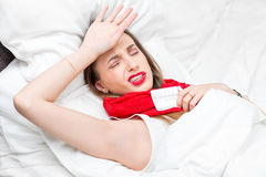 Sick woman in bed Stock Image