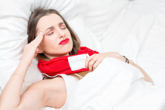 Sick woman in bed Stock Photography