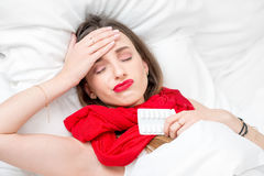 Sick woman in bed Royalty Free Stock Photo