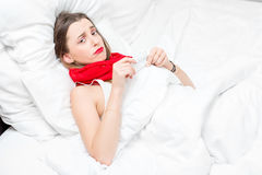 Sick woman in bed Royalty Free Stock Image