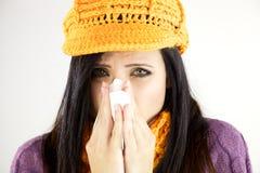 Sick woman blowing handkerchief Stock Photo