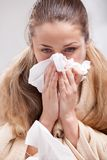 Sick woman blowing her nose Stock Photography