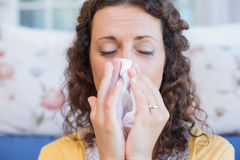 Sick woman blowing her nose Royalty Free Stock Photo