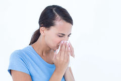 Sick woman blowing her nose. On white background Stock Photography