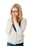 Sick woman blowing her nose Stock Photos