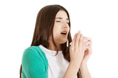 Sick woman blowing her nose Royalty Free Stock Image
