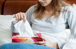 Sick woman with box of tissues Royalty Free Stock Photography