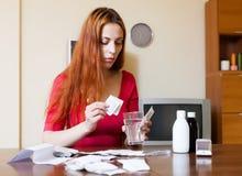 Sick woman brewing herbal tea Stock Photo