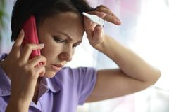 Sick woman calling to the doctor Stock Photography