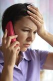 Sick woman calling to the doctor Stock Images