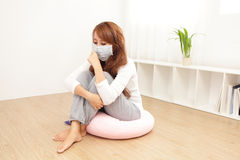 Sick Woman caught Cold and fever. Sick Woman caught Cold and cough at home. asian female Royalty Free Stock Photography