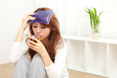 Sick Woman caught Cold and fever Stock Photography