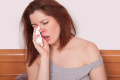 Sick Woman Caught Cold. Sneezing into Tissue. Headache. Photo retouched with special care and attention by professional retoucher in dodge and burn method. all Stock Images