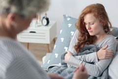 Sick woman with chills. Sick women with chills lying in bed with seasonal disease Royalty Free Stock Photos
