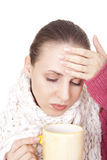 Sick woman with cup in winter scarf Stock Photography