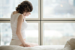 Sick woman on early pregnancy term Royalty Free Stock Photo