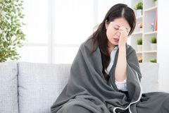 Sick woman feel headache on sofa Royalty Free Stock Images