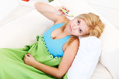 Sick woman with fever Royalty Free Stock Images