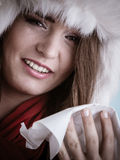 Sick woman with fever sneezing in tissue. Winter time. Stock Images