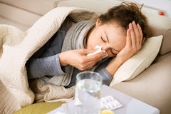 Sick Woman. Flu. Woman Caught Cold. Sneezing into Tissue Royalty Free Stock Photos