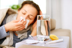 Sick Woman. Flu. Woman Caught Cold. Sneezing into Tissue Royalty Free Stock Images