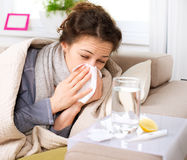 Sick Woman. Flu. Flu or Cold. Sneezing Woman Sick Blowing Nose Royalty Free Stock Image