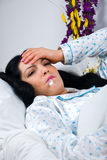 Sick woman with flu and fever Royalty Free Stock Photos