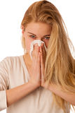 Sick woman with flu and fever blowing nose in tissue isolated ov Royalty Free Stock Image