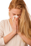 Sick woman with flu and fever blowing nose in tissue isolated ov Stock Photo