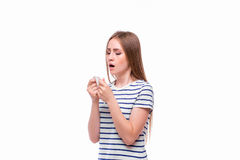 Sick woman with flu and fever blowing nose in tissue Royalty Free Stock Photography