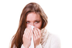 Sick woman girl with fever sneezing in tissue Royalty Free Stock Images